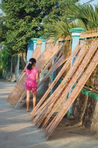 After drying a little in full sun, the rounds are moved to a shaded area. Slowing down the drying time keeps the rice paper from warping. As they finish drying, they unstick from the mats with a gentle popping sound, like slow rain on a quiet morning.